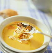 Carrot soup with coconut milk and coconut shavings