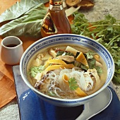 Hot and sour soup with glass noodles, vegetables and meat
