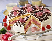 Raspberry cake with yoghurt cream and candied rose petals