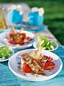 Marinated veal cutlets with red onions and tomatoes