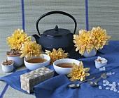Still life with tea, sugar crystals and dahlias