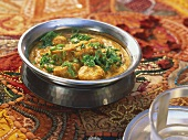 Gatte ka saag (chick-pea flour dumplings in curry sauce, India)