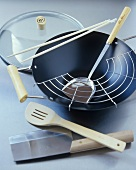 Wok, spatulas and Asian kitchen knife