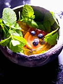 Grapefruit in aspic with berries and lemon balm