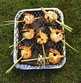 Marinated prawns on lemon grass skewers on barbecue