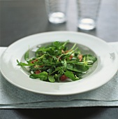 Mixed green salad leaves with diced bacon