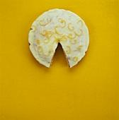 Orange cake with lemon icing, a piece taken