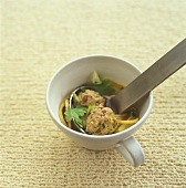 Soup with pork meatballs in a cup