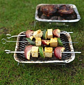 Three vegetable & tofu kebabs on small barbecue out of doors