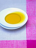 Olive oil in a white soup plate