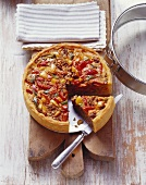 Mince and pepper quiche on a wooden board