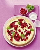 Whole raspberry tart on cake plate