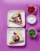 Two pieces of raspberry tart on square, white plates