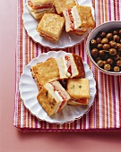 Small toasted ham, tomato and mozzarella sandwiches