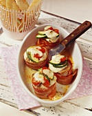 Fillet steaks wrapped in bacon with cheese & vegetable topping