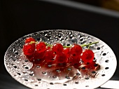 Redcurrants on a slotted spoon