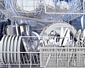 A dishwasher full of clean crockery & cutlery, from inside
