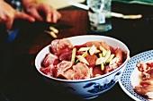 Raw pork with lemon grass in Asian bowl