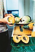 Man with tropical fruit in a kitchen