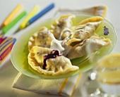 Berry pierogi with cream