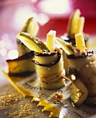 Grilled aubergine rolls filled with cucumber, Parmesan, sesame