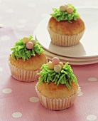 Easter muffins decorated with marzipan grass & sugar eggs