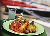 Fried chicken drumsticks with seafood