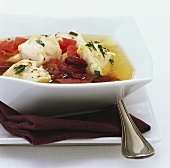 Lime fish with red kidney beans and tomatoes