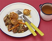 Lamb sausages with fried new potatoes and carrots