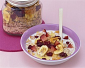 Muesli with banana chips, cranberries and fresh fruit