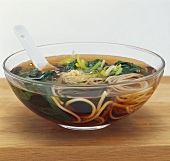Asian noodle soup with spinach and leeks