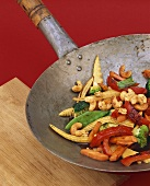 Vegetables and spicy cashew nuts cooked in a wok