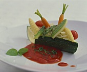 Courgette boat with vegetable filling and tomato sauce