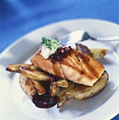 Grilled salmon with potatoes, pepper sauce, horseradish