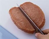 Schmetterlingsschnitzel (Fleischscheibe mittig einschneiden)