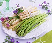 Plate of white and green asparagus, chives and borage