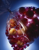 Apricots and redcurrants in plastic bag