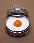 Quark dessert with peach in tin with lid