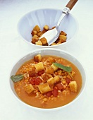 Carrot and pumpkin soup with rice and croutons