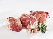 Three lamb shanks with rosemary and garlic cloves
