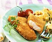 Breaded fish with potato salad