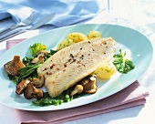 Fried fish fillet with mushrooms and boiled potatoes