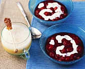 Red fruit compote with custard & eggnog with sugar swizzle stick