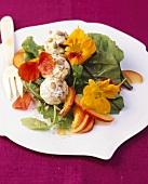 Soft cheese balls with nasturtium flowers