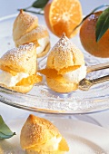 Profiteroles with mandarin and cream filling