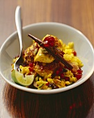 Saffron rice with chicken breast, spices & pomegranate seeds