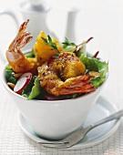 Deep-fried prawns in tempura batter on mixed salad