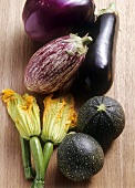 Various types of aubergines and courgettes
