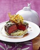 Loin of venison with olive crust and brittle on cabbage
