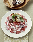 Carpaccio tartufato (Beef carpaccio with truffle and Parmesan)
